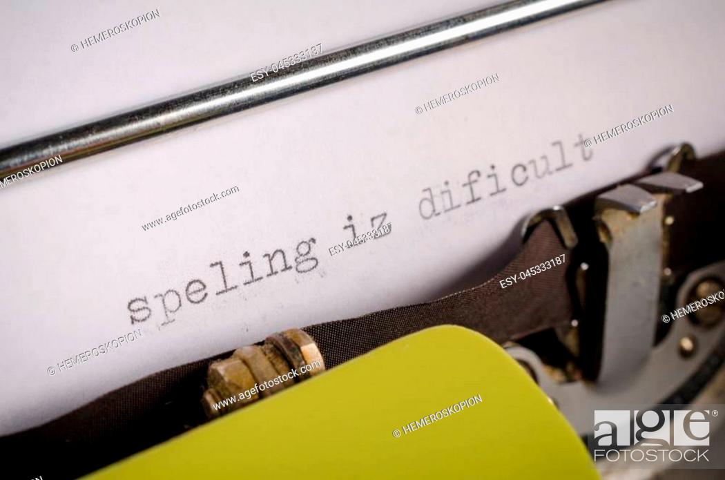 Stock Photo: Old typewriter with text that contains spelling mistakes, a concept.