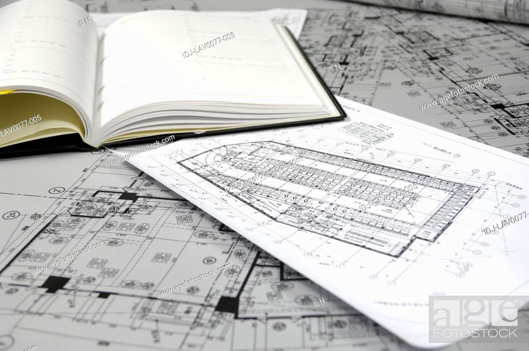 Stock Photo: Close-up of blueprints and diary in an office.