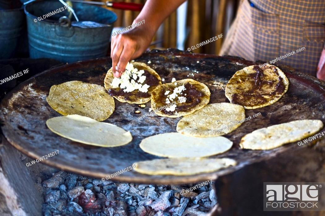 Stock Photo: Chef preparing tortilla in a kitchen, Santo Tomas Jalieza, Oaxaca State, Mexico.