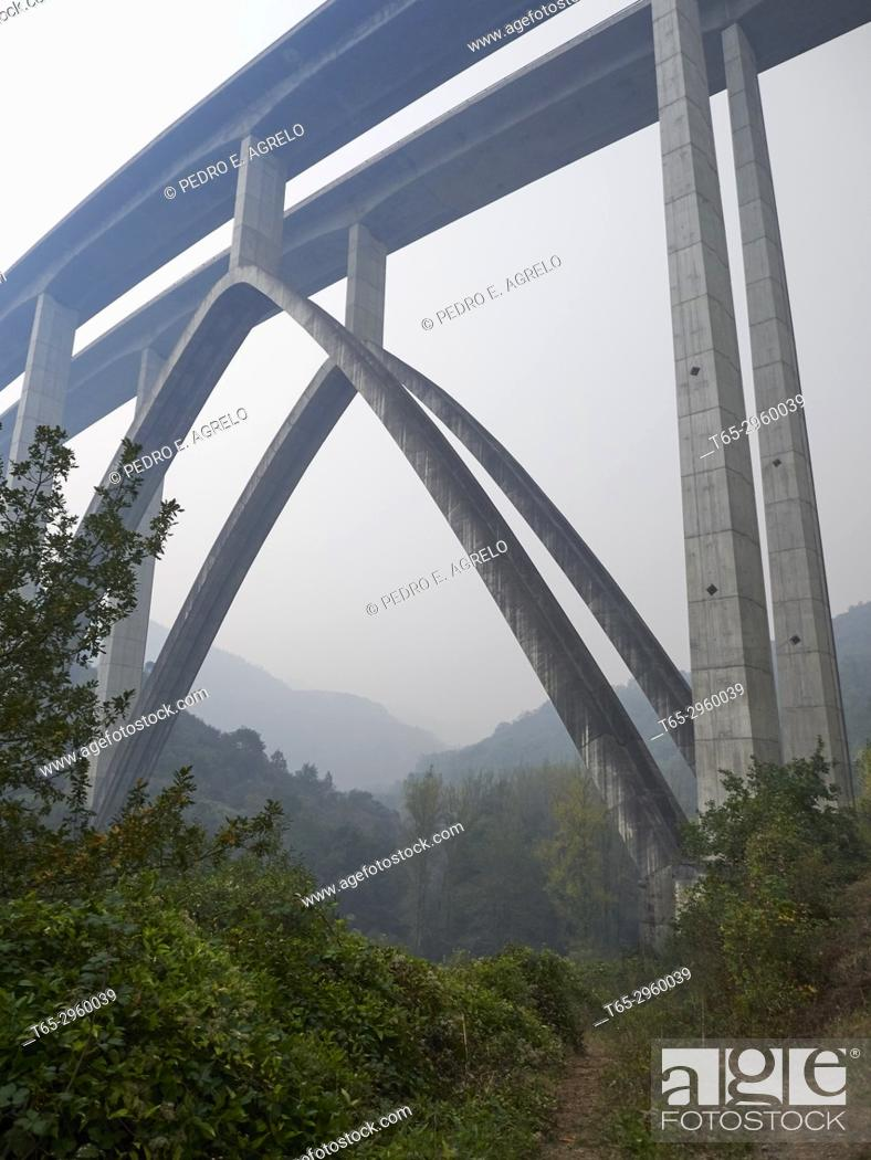 Stock Photo: Bridge of the highway A-6 Coruña-Madrid, near the town of Becerreá, in Lugo. The large number of forest fires in the Ancares Lucenses, Nature Reserve.