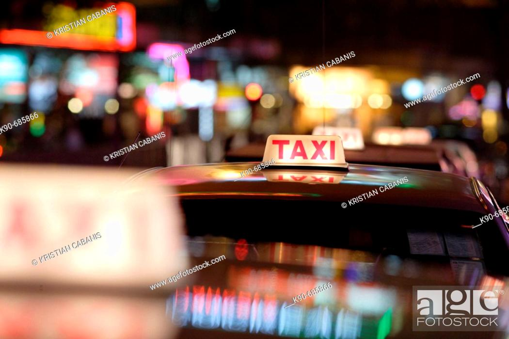 Stock Photo: Close up of a taxi sign on the roof of taxis, standing in a row in the amusement center of Wanchai, Hong Kong Island, Hong Kong, China, East Asia.