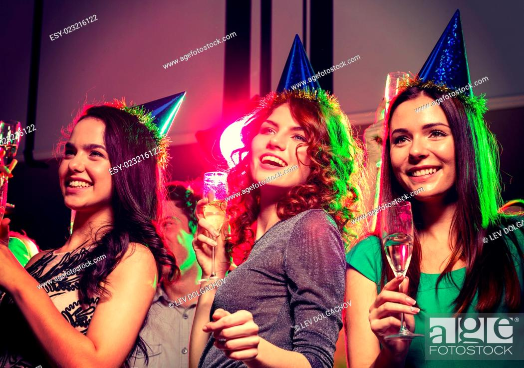 Stock Photo: party, holidays, celebration, nightlife and people concept - smiling friends with glasses of champagne in club.