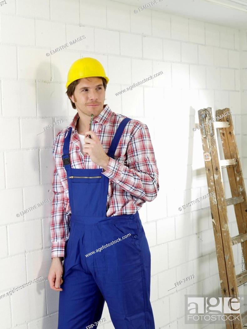 Stock Photo: Construction worker wearing a helmet.