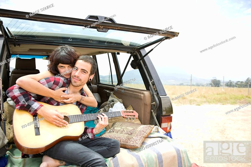 Stock Photo: Young couple with guitar.