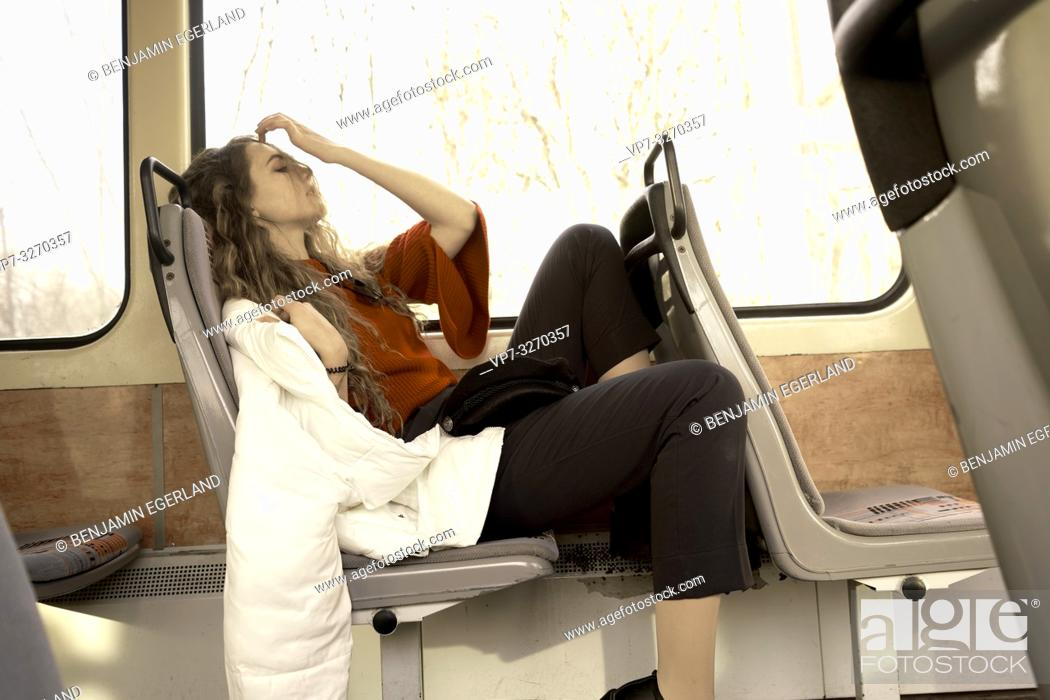 Stock Photo: young woman sitting in public transport, in city Cottbus, Brandenburg, Germany.
