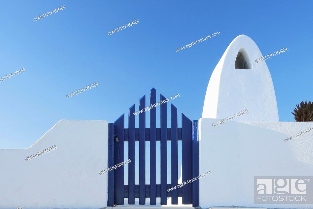 Stock Photo: Greece, Traditionally Greek gate and chimney in oia village at Santorini.