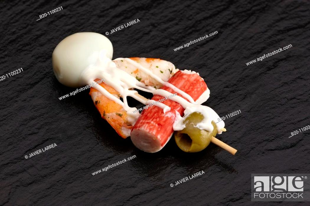 Stock Photo: 'Pintxo' of chatka, shrimp, quail egg and olive, Barakaldo, Bizkaia, Basque Country, Spain.