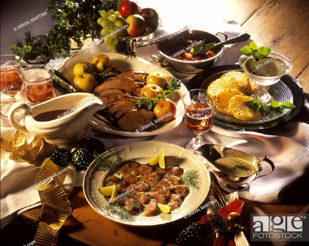 Stock Photo: Christmas menu with fish, roast wild boar and pineapple (1).
