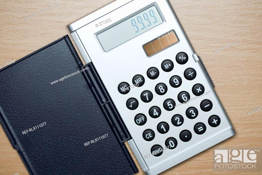 Stock Photo: Close up of silver calculator from above.
