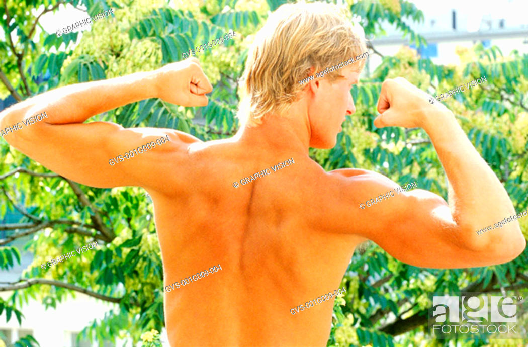 Stock Photo: Rear view of young man flexing biceps.