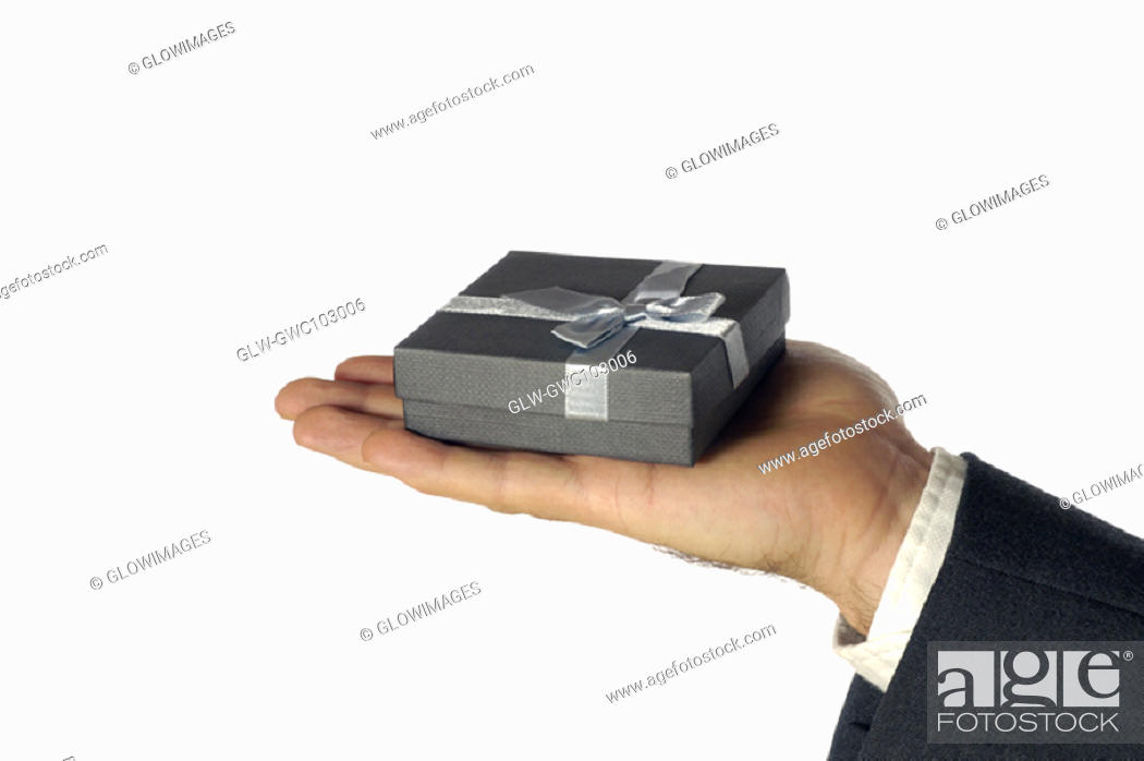 Stock Photo: Close-up of a businessman holding a gift.