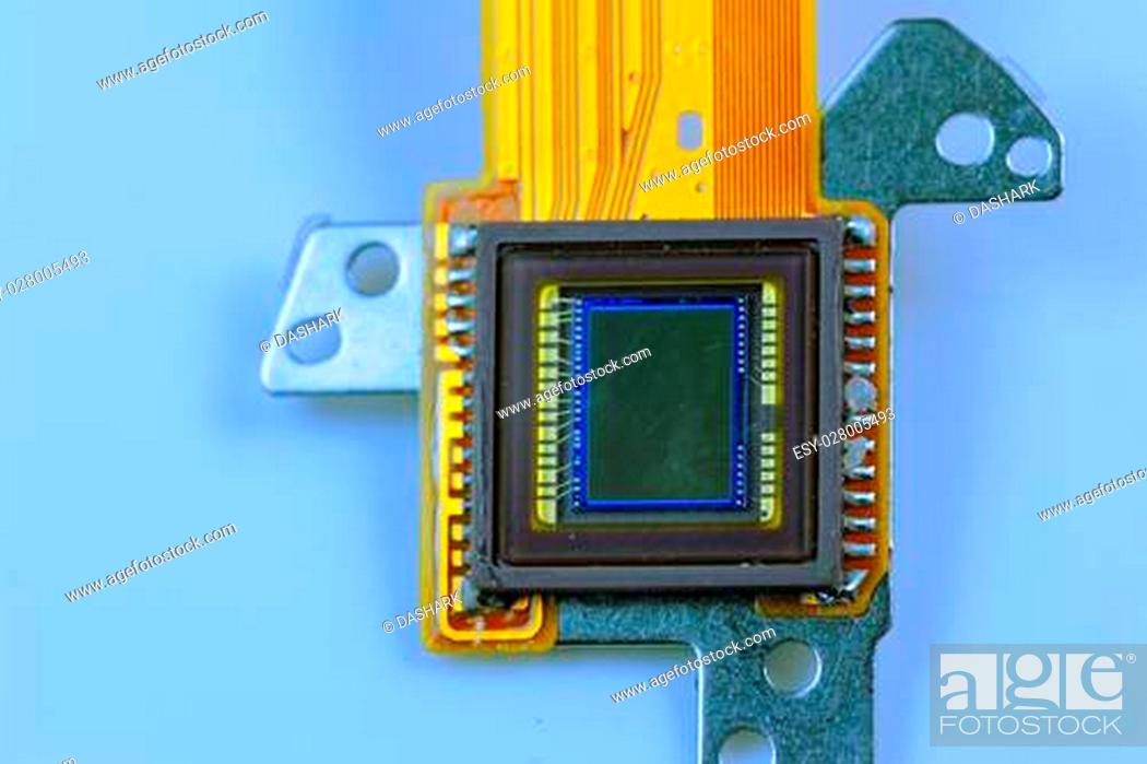 Stock Photo: CCD sensor on a card of digital camera with fiber optical background.