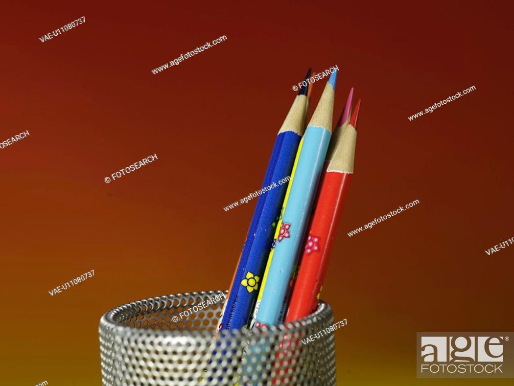Stock Photo: school stationery, pencil holder, stationery, business supplies, multi colored pencil, writing instrument, artifact.