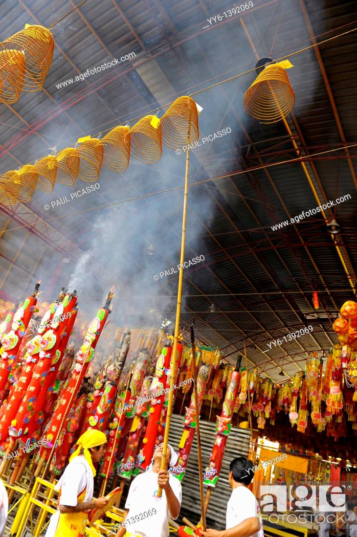 Stock Photo: Devotees hang incense swirls and ceremonial lanterns high among the rafters ,Vegetarian festival at San Jao Sieng Kong shrine , wat sung heng yee, Chinatown.