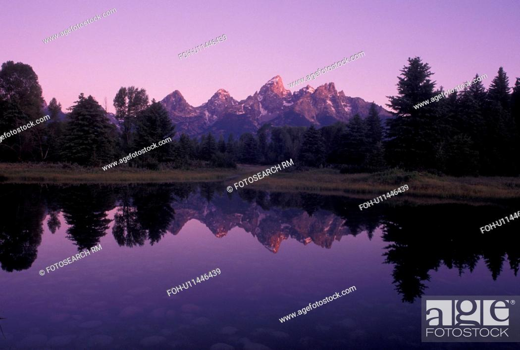 Stock Photo: Grand Teton National Park, WY, sunrise, Snake River, Jackson Hole, Wyoming, Scenic view of the Grand Teton Mountains reflecting in the calm waters of the Snake.