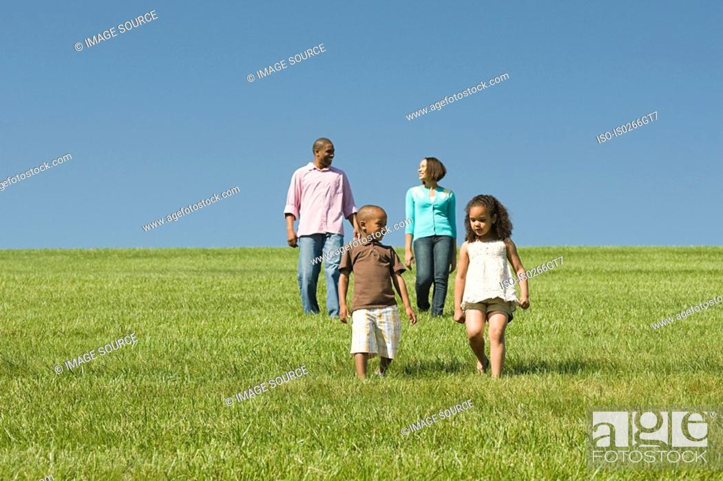 Stock Photo: Family in a field.