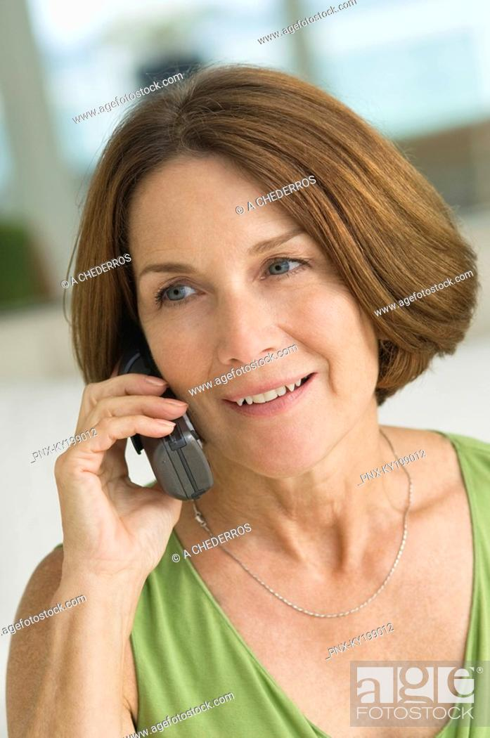 Stock Photo: Woman talking on a mobile phone.