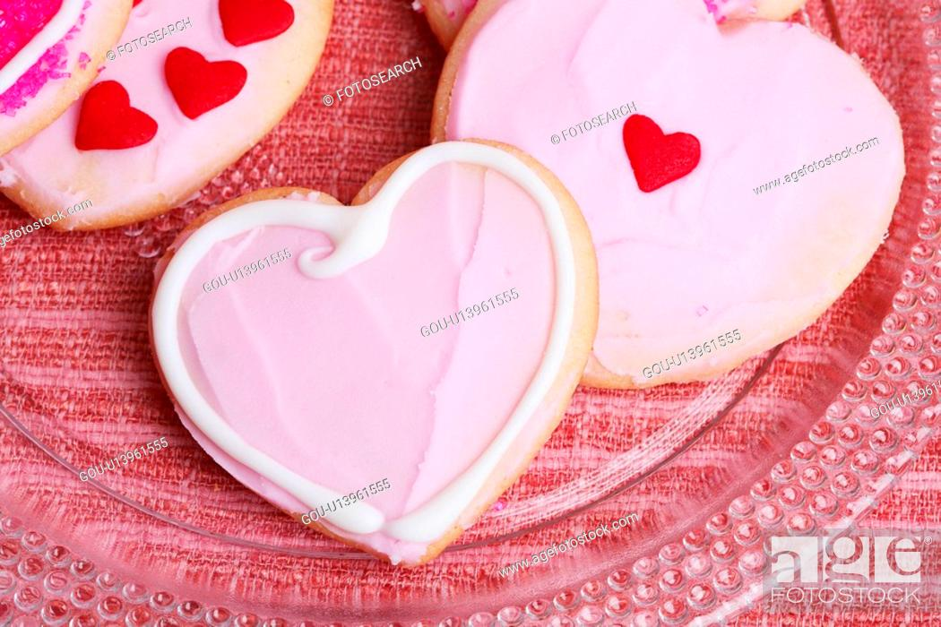 Stock Photo: Pink heart shaped cookies (close-up).