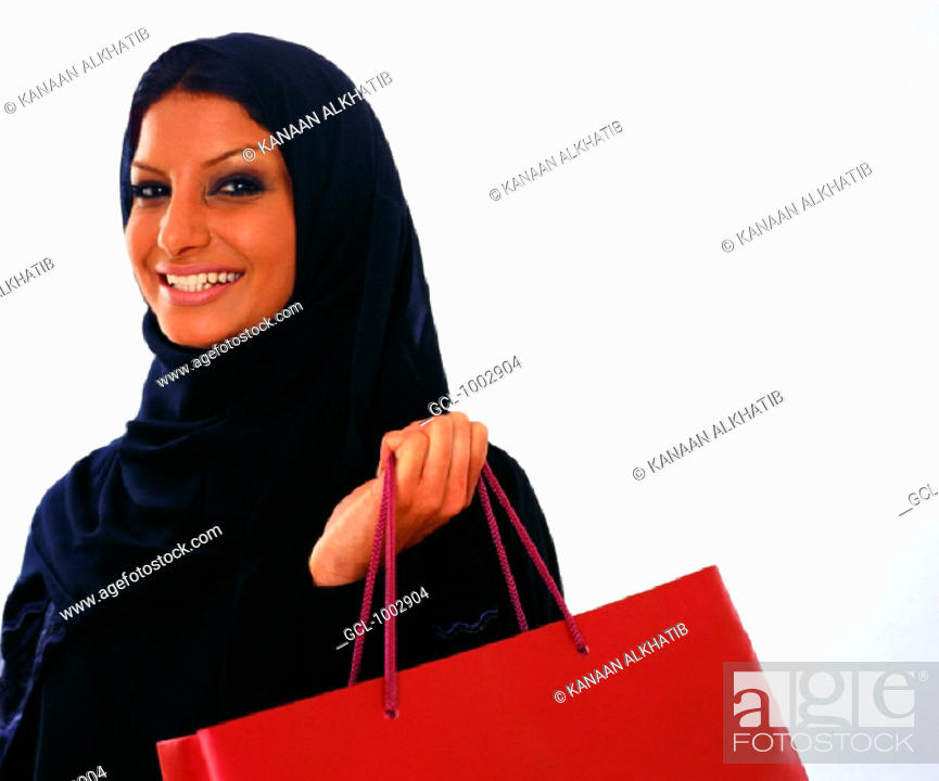 Stock Photo: Arab woman holding a shopping bag.