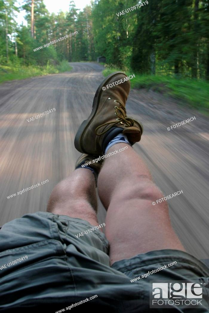 Stock Photo: feet, legs, boots, sitting, pose, highway.
