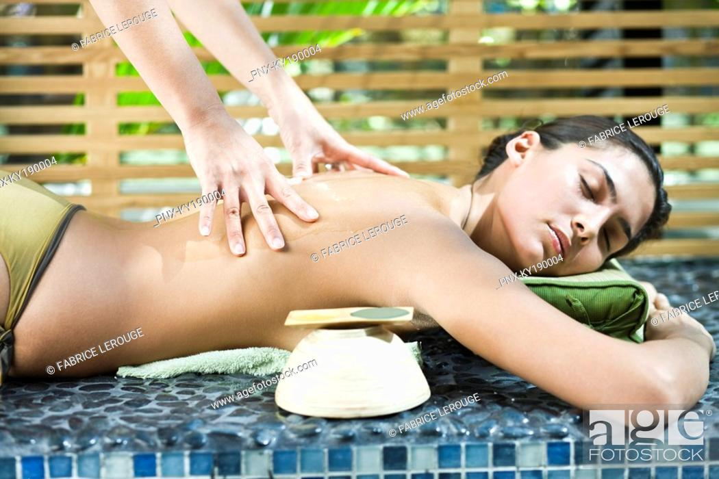 Stock Photo: Woman receiving a back massage.