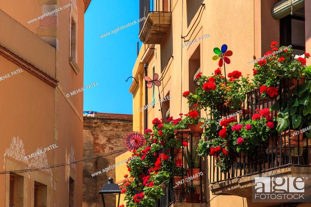 Stock Photo: Bright flowers and plants on balconies in the old town of Tarragona, Catalonia, Spain.
