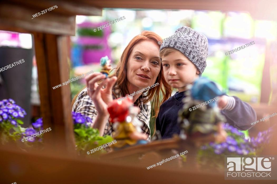 Stock Photo: Mother and son shopping at garden centre.