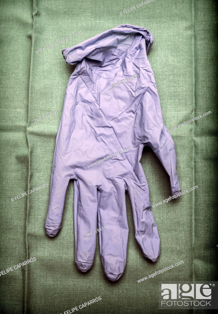 Stock Photo: Glove of latex blue on green cloth in an operating theater, conceptual image.