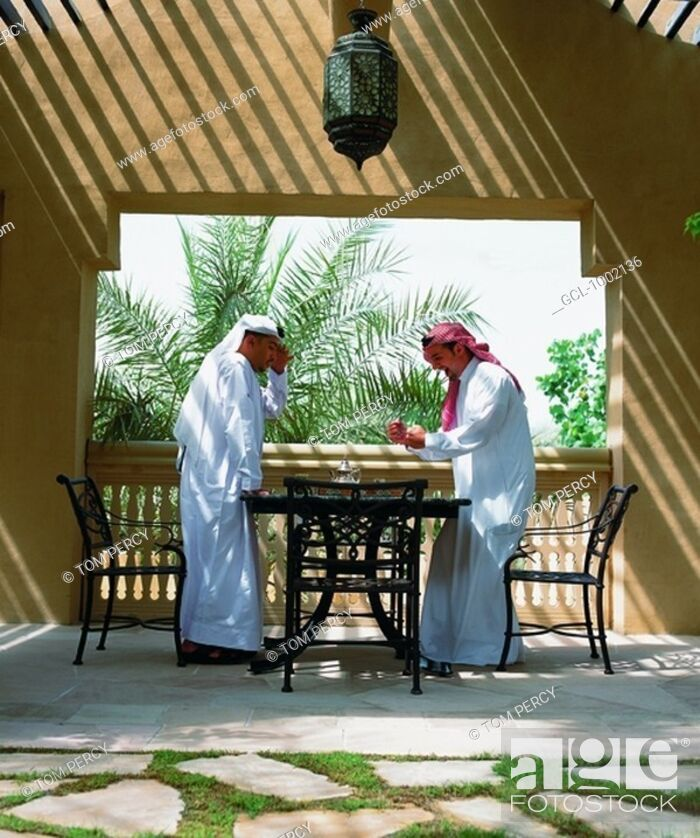 Stock Photo: Arab men playing backgammon.