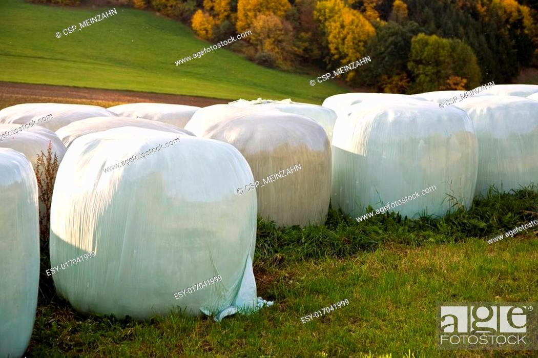 Stock Photo: bale of straw infold in plastic film.