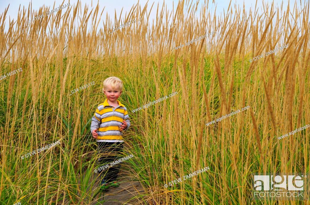Stock Photo: Boy in the Grass.