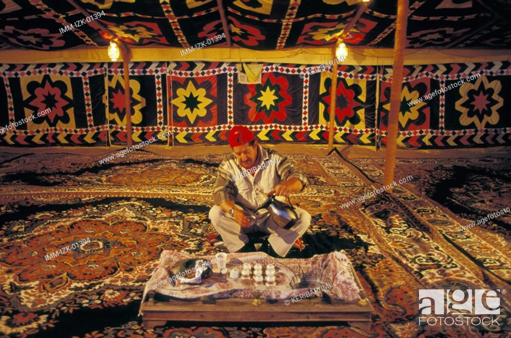 Stock Photo: Serving Traditional Sour Coffee in Traditional Bedouin Tent Dubai, United Arab Emirates, Middle East.