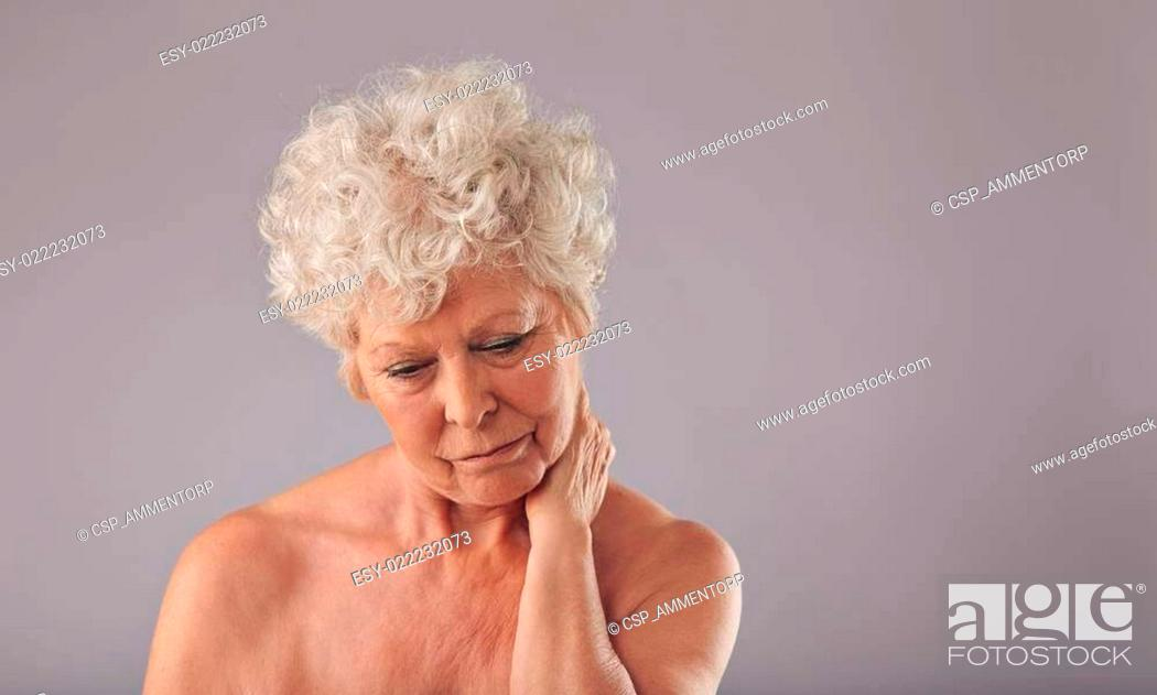 Stock Photo: Senior woman suffering from neck pain.