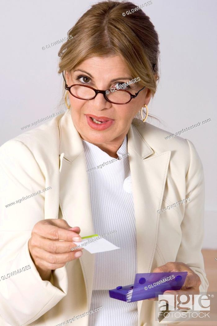 Stock Photo: Portrait of a businesswoman giving a business card.