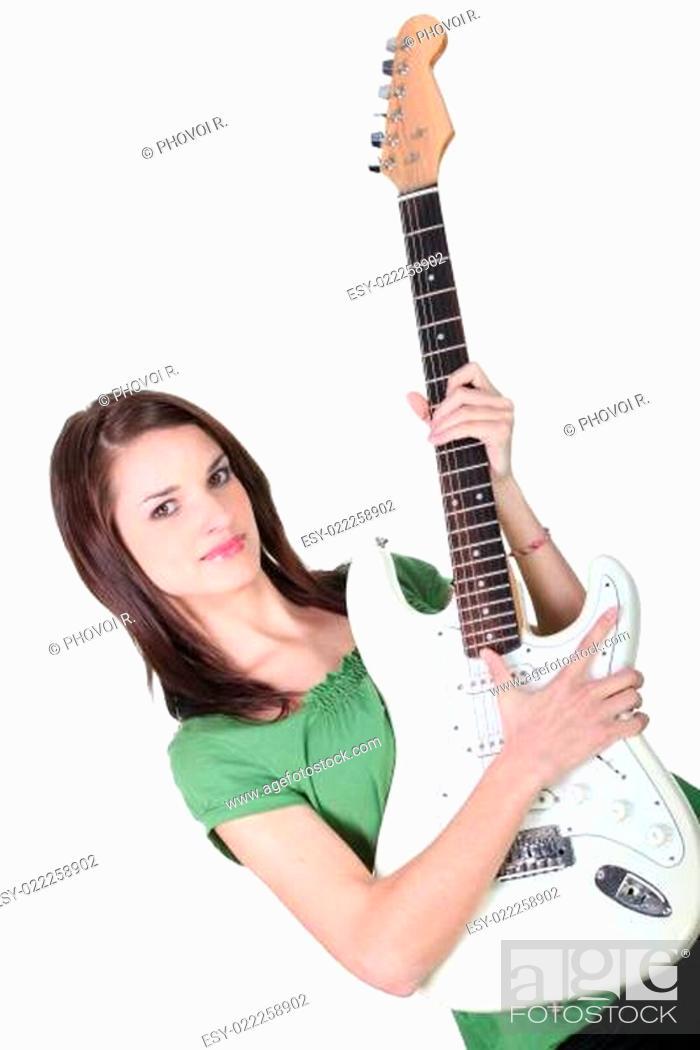 Stock Photo: Girl playing guitar, studio shot.