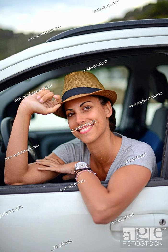 Stock Photo: Attractive young woman in car, Ibiza, Balearic Islands, Spain.