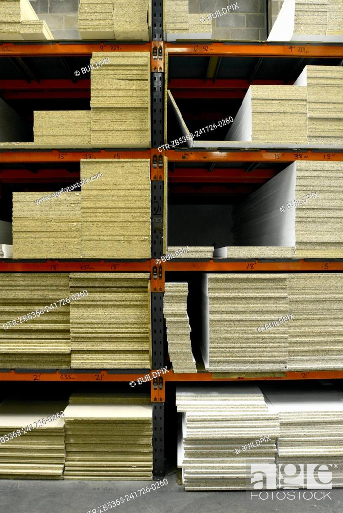 Stock Photo: Stacked wood in timber merchant warehouse.