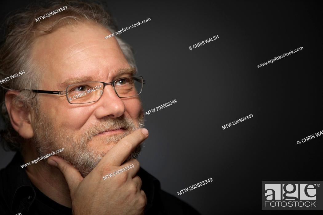 Imagen: Man beard portrait glasses 50 mature smiling.