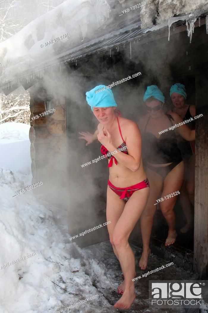 Stock Photo: Women by Smoke Sauna in Sokka Holiday Resort, Valga County, Estonia.