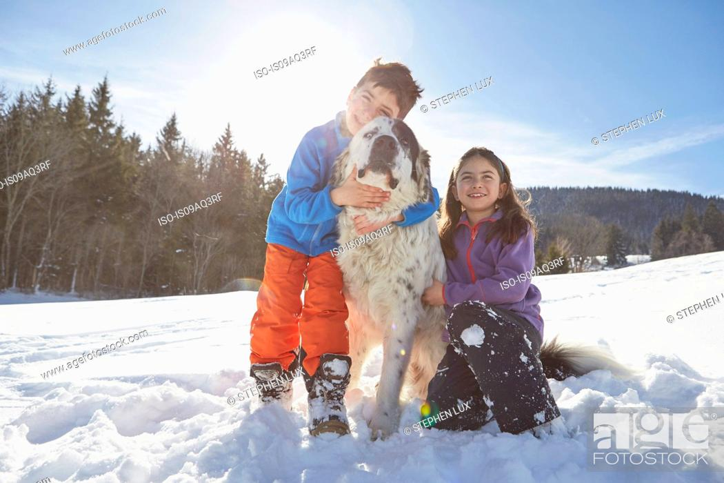 Stock Photo: Brother and sister with their pet dog.