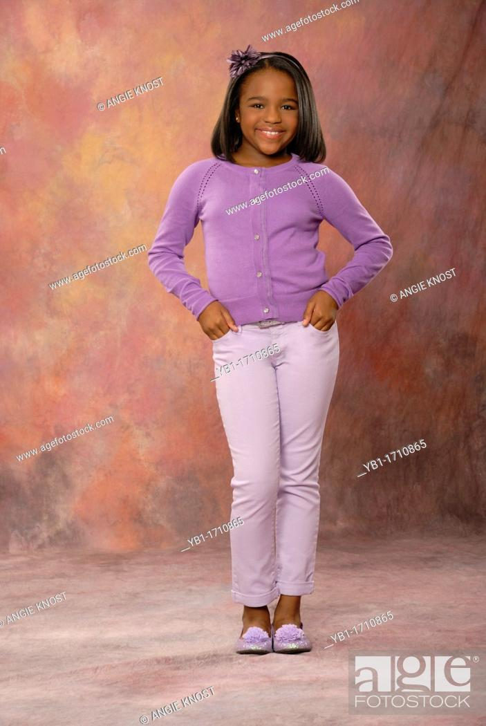 Smiling, cute 10 year old girl, wearing a fashionable outfit and ...