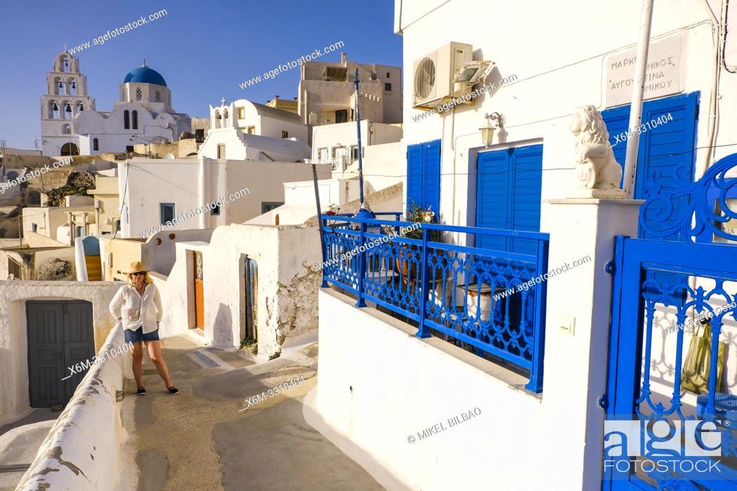 Stock Photo: Woman and street view. Pyrgos village. Santorini. Cyclades islands. Greece.