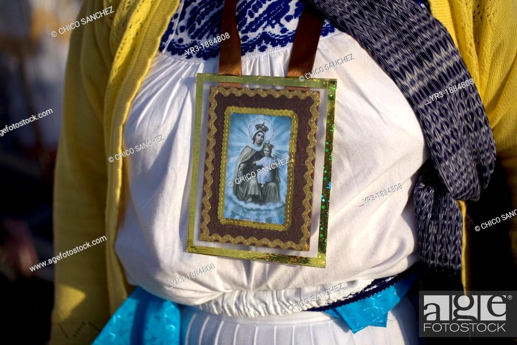 Stock Photo: An indigenous Mazahua woman wearing an image of Our Lady of Mount Carmel stands outside of the Our Lady of Guadalupe Basilica in Mexico City, December 9, 2012.