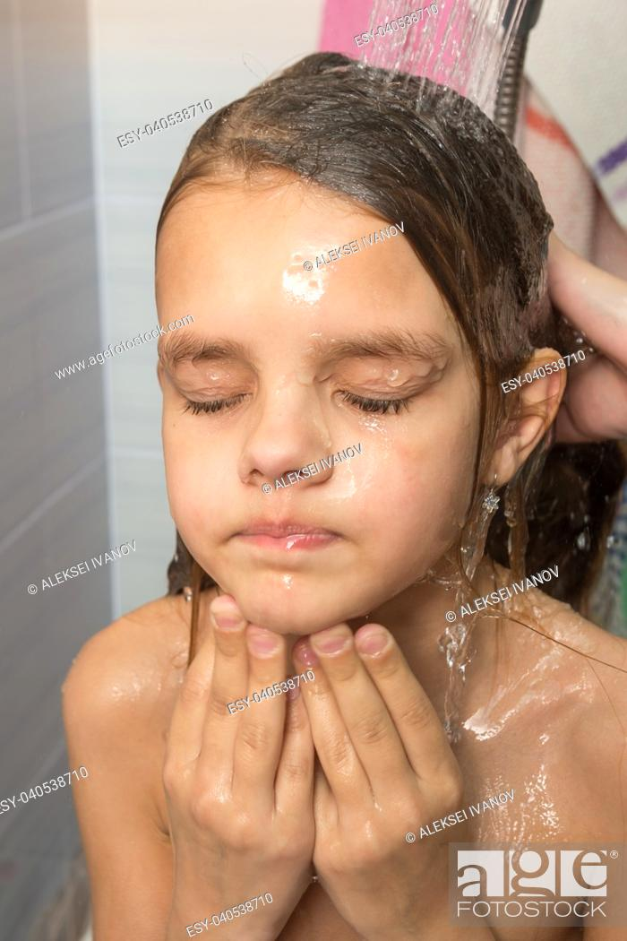 Stock Photo: Face of the girl poured by mother from the shower, close-up.