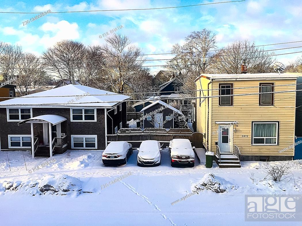 Stock Photo: A happy winter scene. Blue sky, sunshine, fresh snow in a city street, Halifax, No a Scotia, Canada.