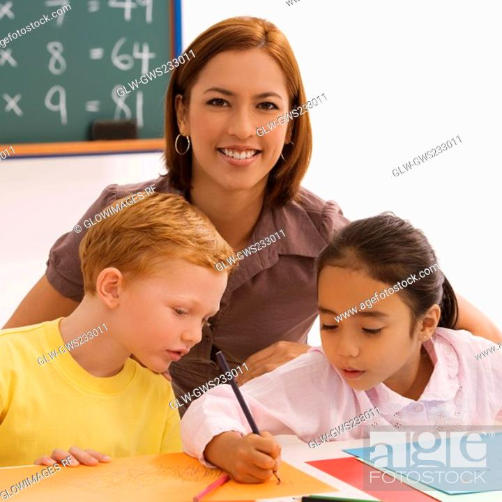 Stock Photo: Female teacher teaching her two students.