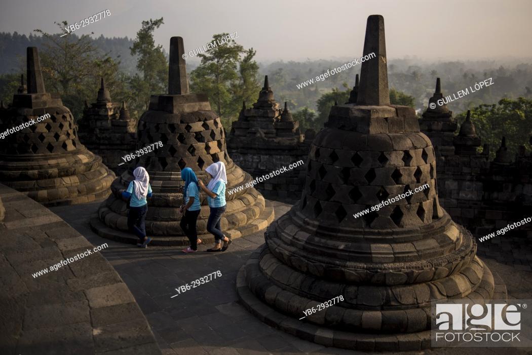 Stock Photo: Muslim local tourists at the Borobudur Temple in Java, Indonesia.