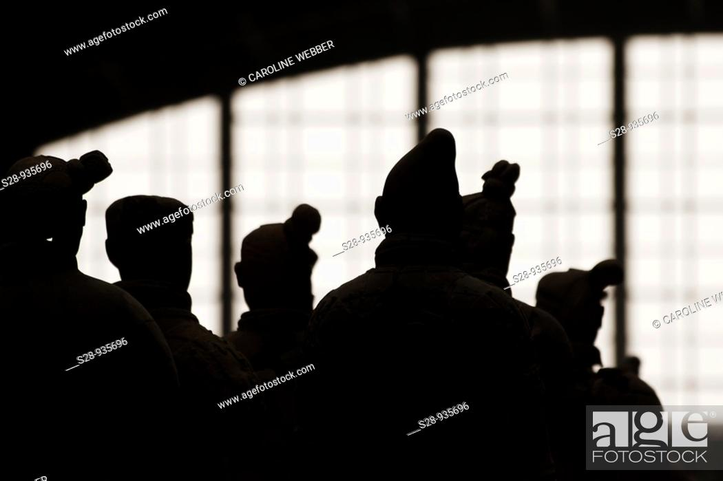 Stock Photo: silhouettes of the Terra Cotta Warriors in Xi'an China.