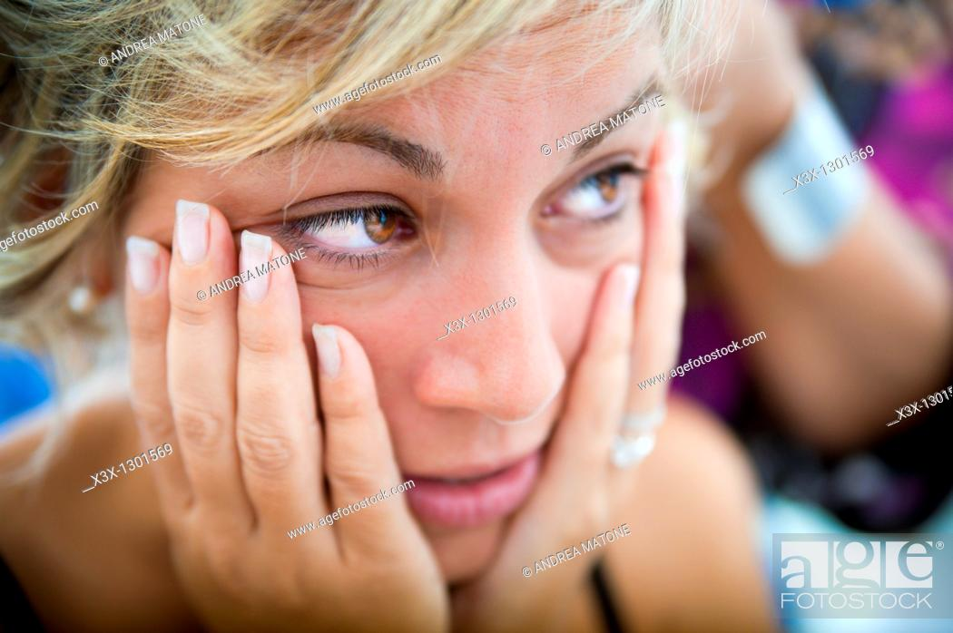 Stock Photo: Woman posing with hands on her face.