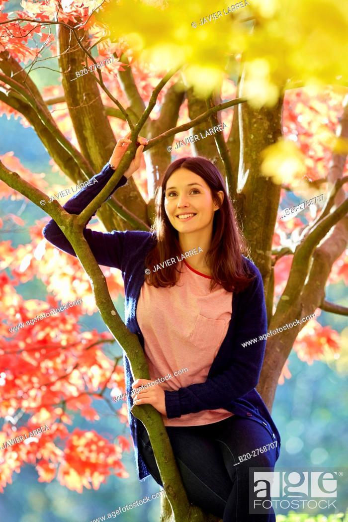 Stock Photo: Woman in the forest, Trees in Autumn, Pagoetako Parke Naturala, Pagoeta Natural Park, Aya, Gipuzkoa, Basque Country, Spain.